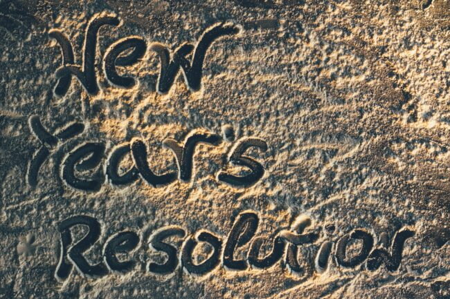 New Years Resolutions written in the sand