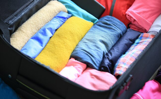Packing clothes in suitcase