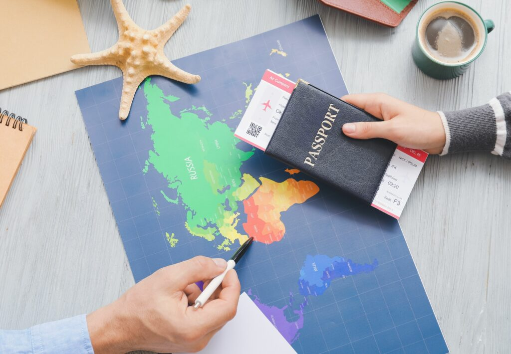 A map and passport on the table deciding where to travel too
