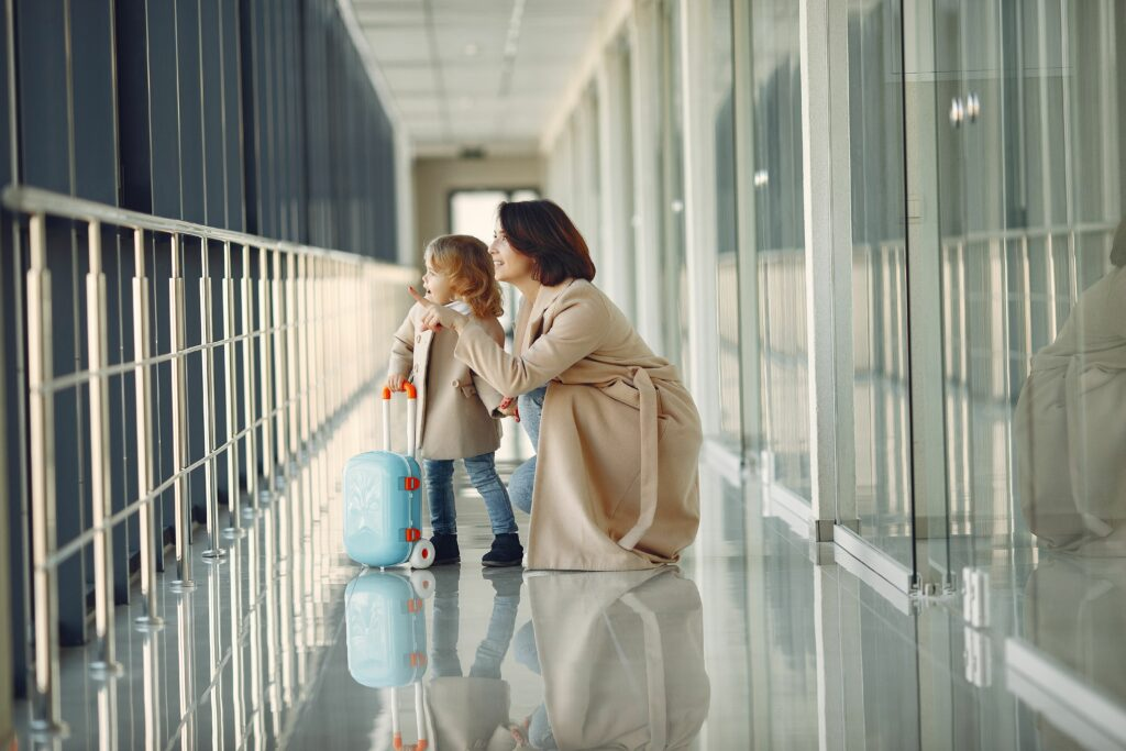 Amazed girl with mother in airport hallway