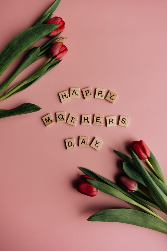 Happy Mother's Day spelled out in scrabble pieces with flowers