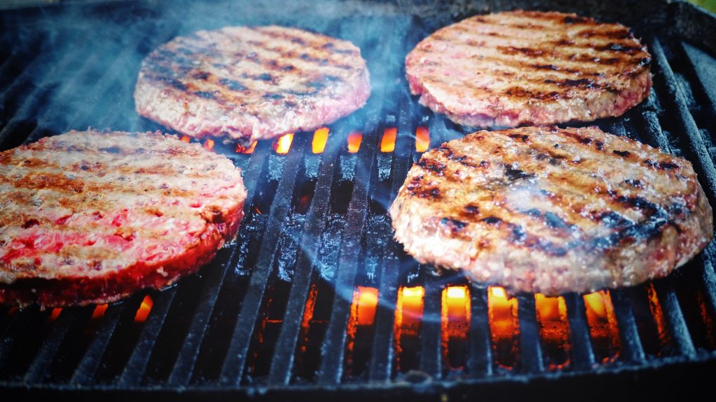Hamburgers cooking on the grill